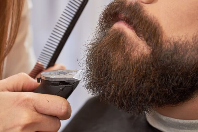Beard being trimmed
